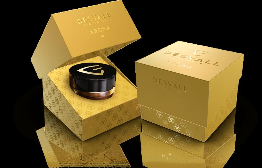 Embalagem dourada da essência Krona